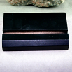 A Black Tile Stand For Ceramic Tiles
