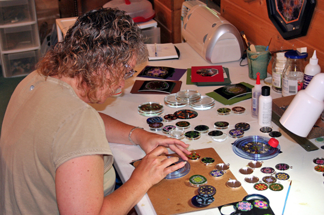 Melissa Burness creating kaleidoscope pendants.