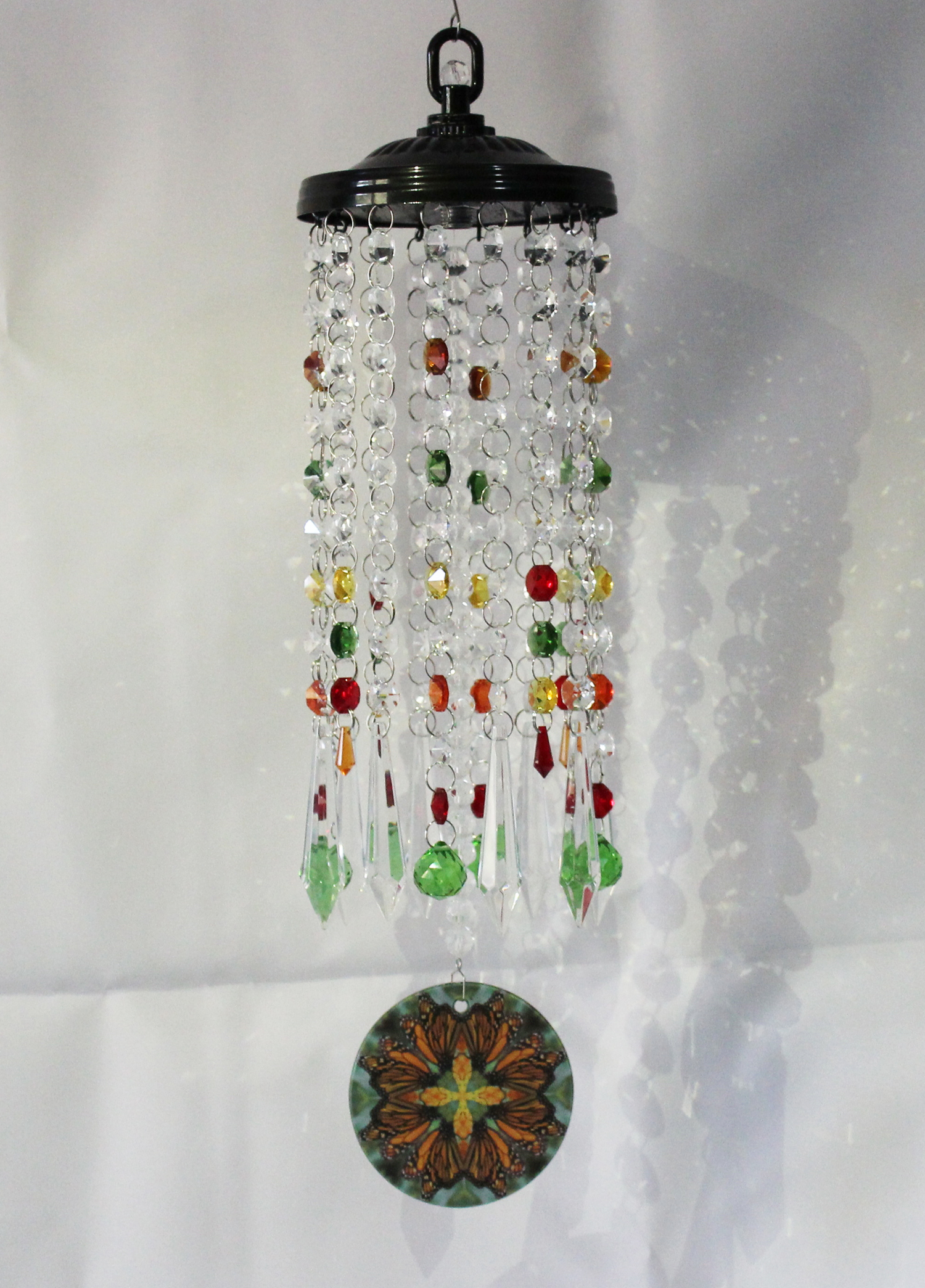 A Crystal Suncatcher Chandelier With A Glass Monarch Butterfly Mandala Centerpiece